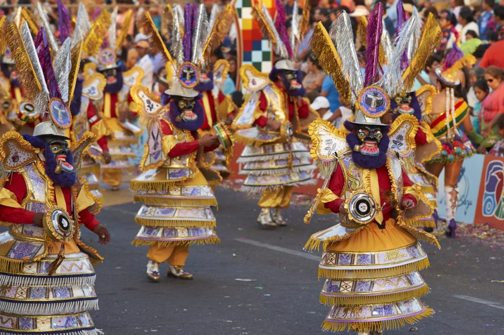 Morenada dance group in traditional Andean costume performing at the annual Carnaval Andino con la Fuerza del Sol in Arica, Chile.