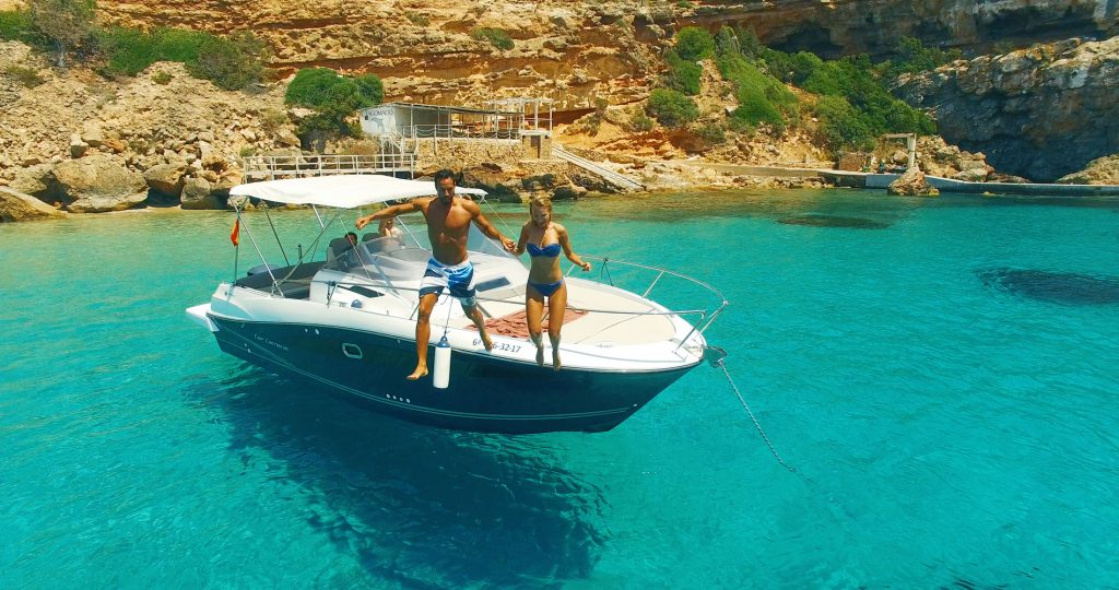 Aerial view of beatiful sea with yacht and beautiful couple